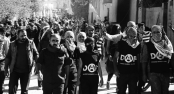 Members of Revolutionary Anarchist Action (DAF) partake in a demonstration outside of Kobane in northern Syria.