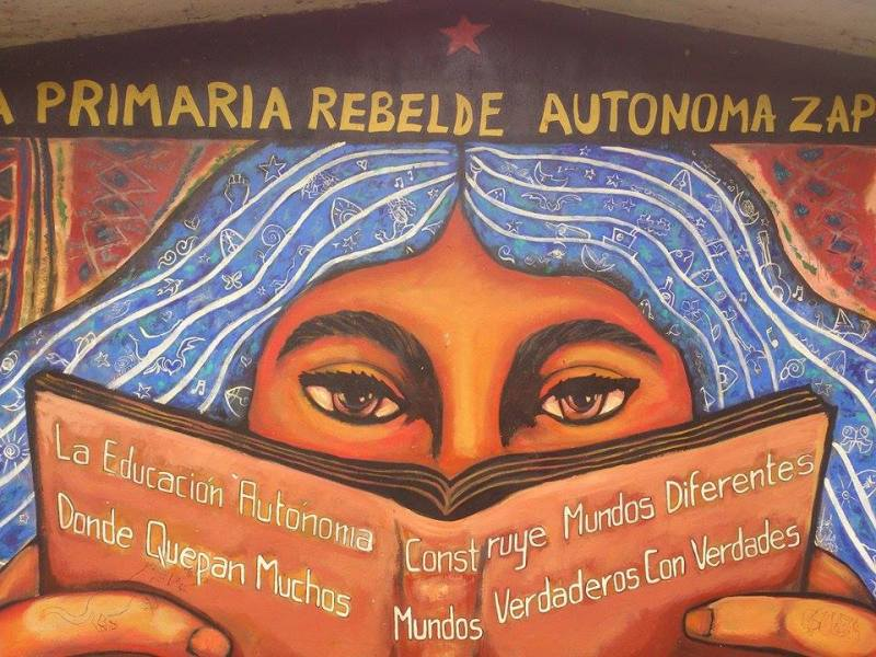 """Build different worlds where many worlds fit"" mural of the Zapatista autonomous rebel elementary school in Oventic, Chiapas."