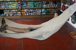 Michelle tries out one of the sisal hammocks.
