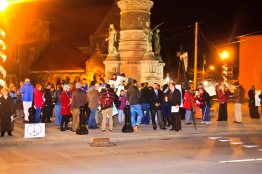 The crowd gathers in front of the Civil War memorial in Oneida Square.