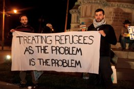 Brendan Maslauskas-Dunn and Derek Scarlino of Love and Rage showing their solidarity with refugees.