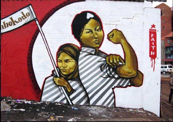Graffiti-Art-by-Faith47-You-Strike-a-Woman-You-Strike-a-Rock