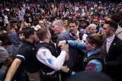 CHICAGO, IL - MARCH 11: Protestors and Trump supporters clash after an event was postponed where republican presidential candidate Donald Trump was to speak at the University of Illinois at Chicago Pavillon in Chicago, IL on Friday March 11, 2016. (Photo by Jabin Botsford/The Washington Post via Getty Images)