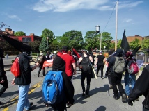 Members of various antifa factions gather in Syracuse and march to the rally spot.