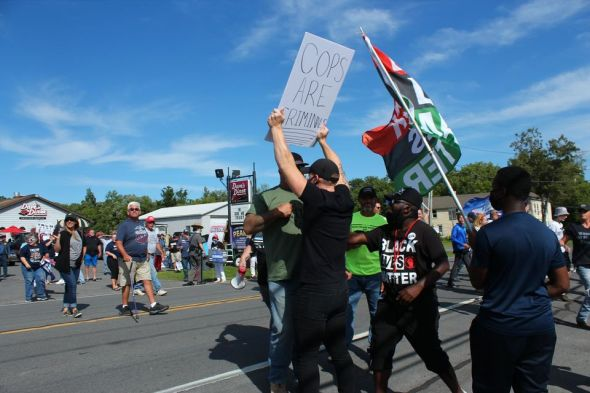 Trump and Tenney supporters stream across the road and attempt to start fights with BLM activists. The BLM activists kept their cool. (Photo credit: Eamon Handzel)