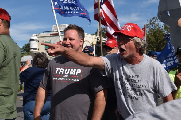 Trump supporters charged across the road and encircled peaceful Black Lives Matter activists. They then hurled threats at them and tried to instigate fights. Trump and Tenney supporters rally in front of Dave's Diner which sponsored and promoted the event. (Photo Credit: Love and Rage)