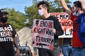 """A Black Lives Matter activist holds a sign that reads """"End Right Wing Terrorism"""" - a fitting statement for the volatile political climate we find ourselves in. (Photo Credit: Love and Rage)"""