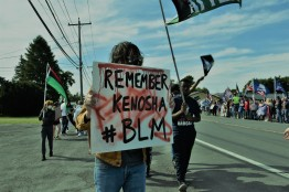 Remember Kenosha, WI where police shot shot Jacob Blake in his back in front of his children, and where two BLM activists were killed and one critically injured by teenage white militia member Kyle Rittenhouse. Trump and Tenney supporters rally in front of Dave's Diner which sponsored and promoted the event. (Photo Credit: Love and Rage)