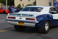"""A trump supporter drives by in his """"Overtime Outlaw"""" car. (Photo Credit: Love and Rage)"""