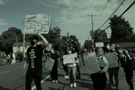 Black Lives Matter activists and Utica Abolitionists on the march. (Photo Credit: Love and Rage)